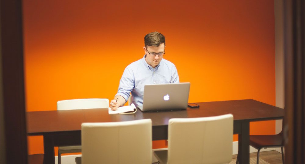 Man creating powerpoint presentation on mac