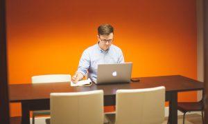 Man creating powerpoint presentation on mac