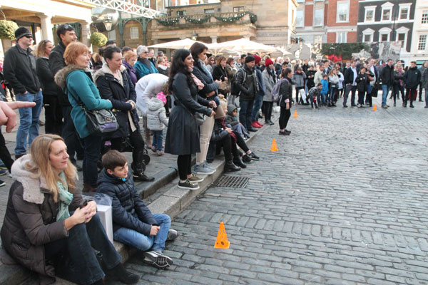 attentive audience watching street performer