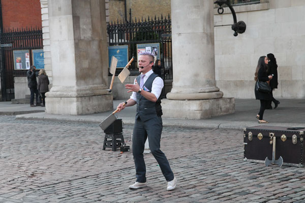 Street performer juggling meat cleavers