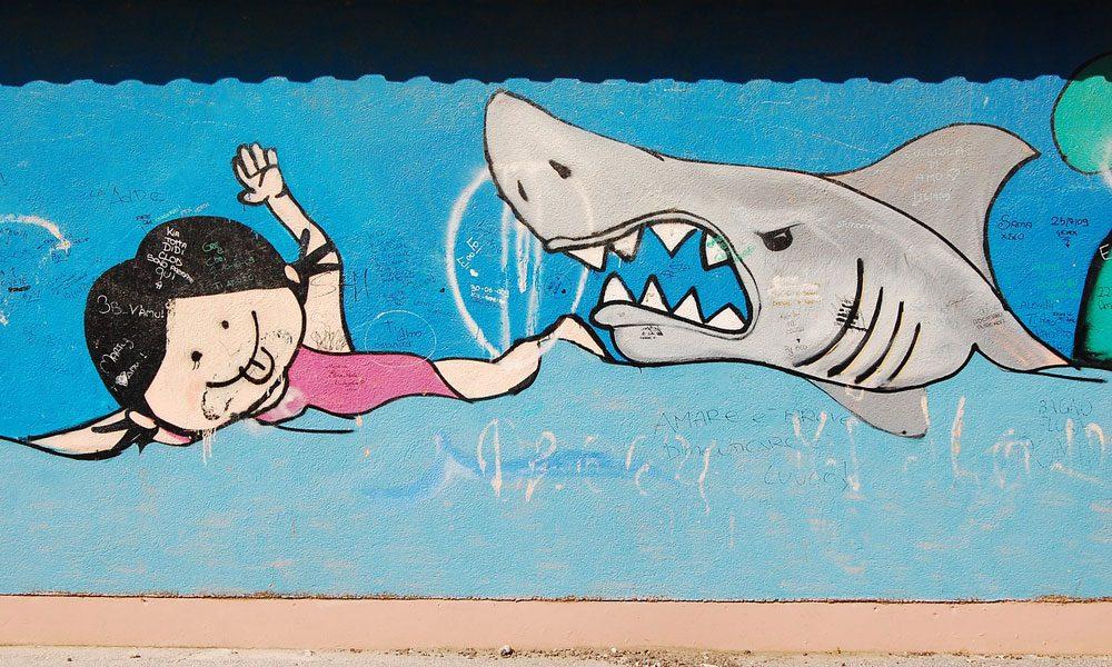 shark closing in on little girl