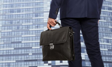 Business man with briefcase pitching to investors