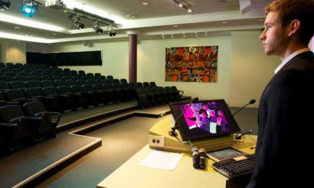 speaker practising in empty auditorium