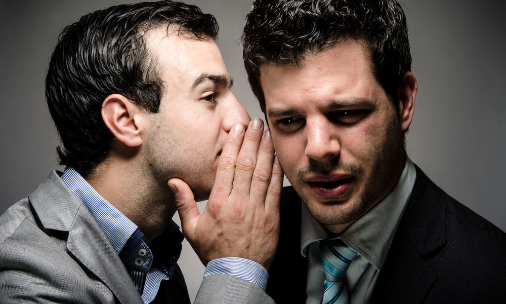 whispering a secret to a nervous speaker