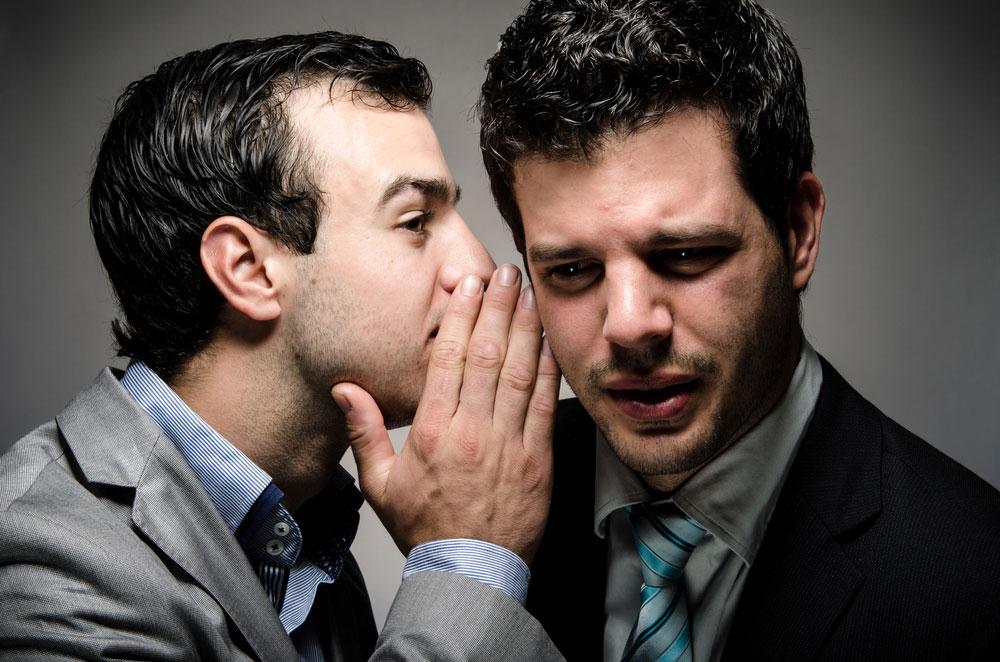 whispering a secret to a nervous speaker