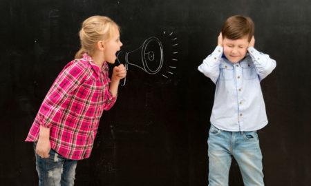 girl shouting at boy through loudhailer