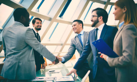 salesman shaking hands after successful pitch