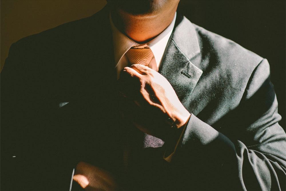 Successful speaker tying tie