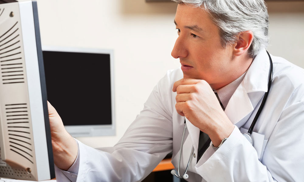 doctor looking at presentation on computer screen