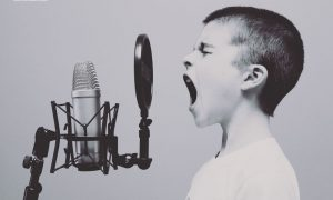 young person shouting into microphone