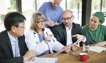 Healthcare professionals having team briefing