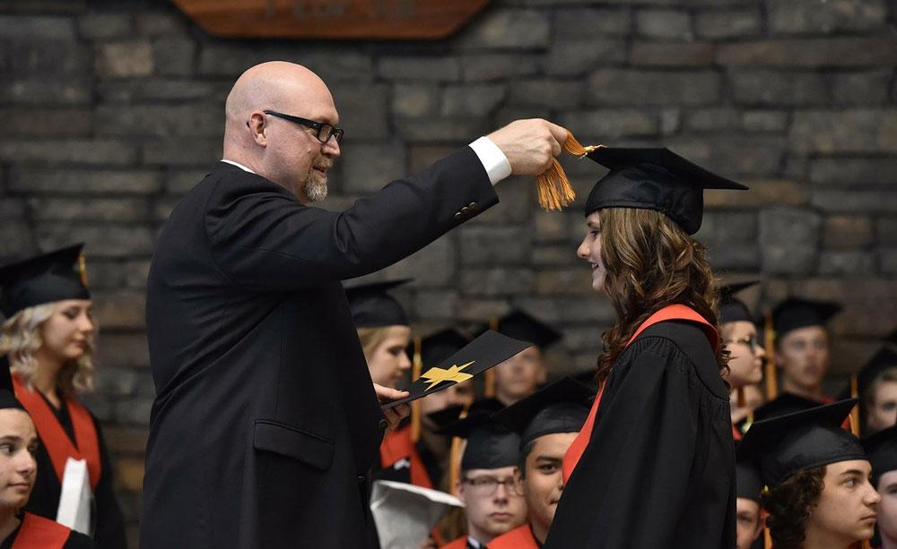 Student receiving degree in presentation design