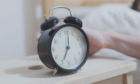 alarm clock beside bed