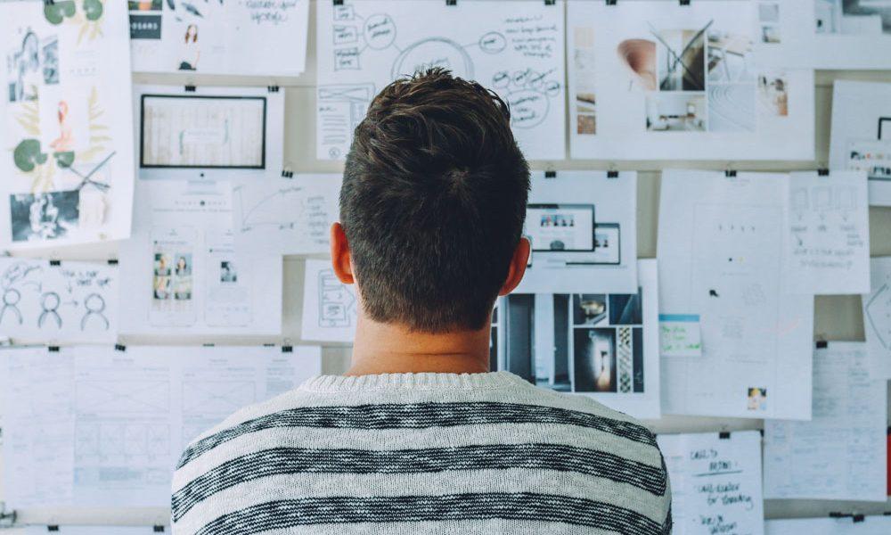 male speaker brainstorming presentation on whiteboard