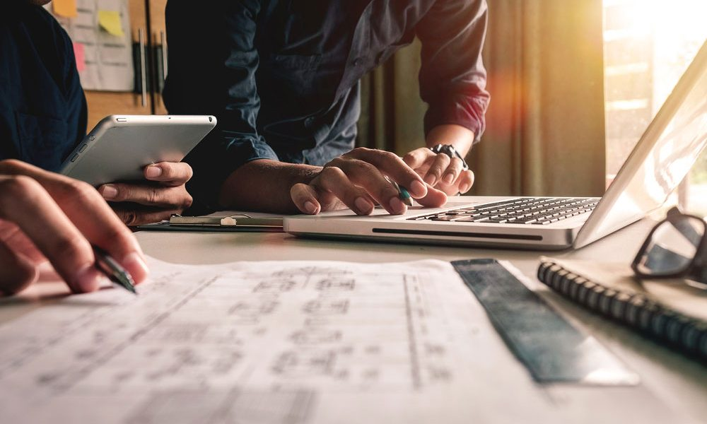 2 men collaborating on presentation design