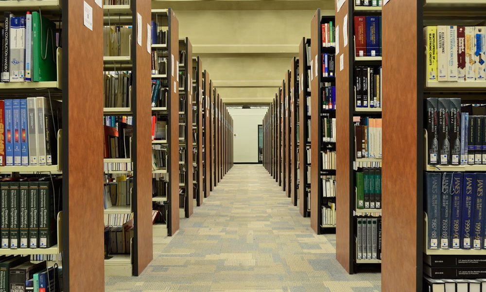 rows of bookcases in public library