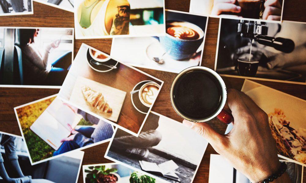 Photos spread out on desk