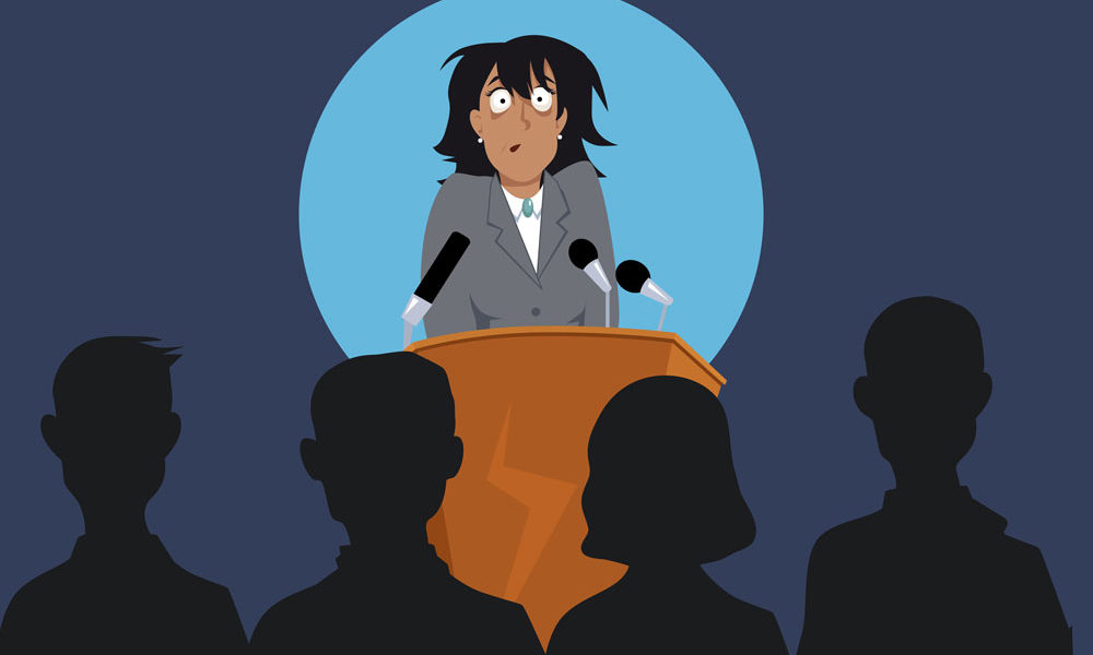 terrified female speaker at lectern