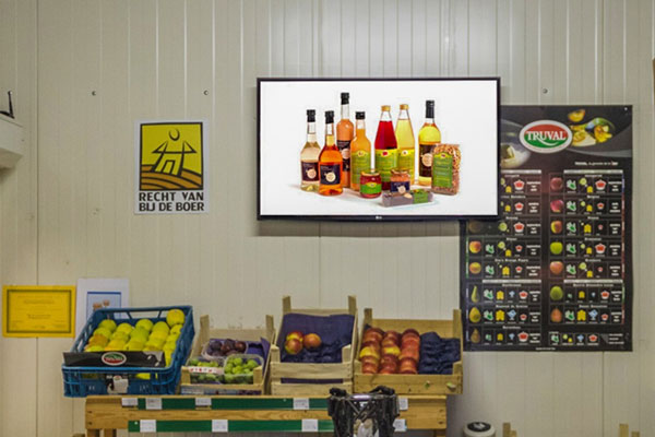 signagetube screens showing discounted fruit offers in food store