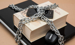 laptop book and iphone tied together with heavy duty chain to protect them